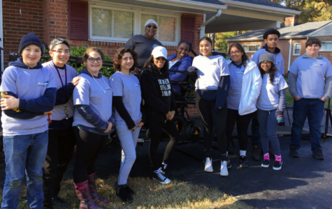 Midlo RAMPS club builders: Skylar West, Mariam Salem, Samone Smith, Gurleen Jaswal, Matthew Suddreth, Rachel Ferguson, Gavin Holloway, and Trinity Brown, celebrate building the 406th ramp, with their client Monaiya.