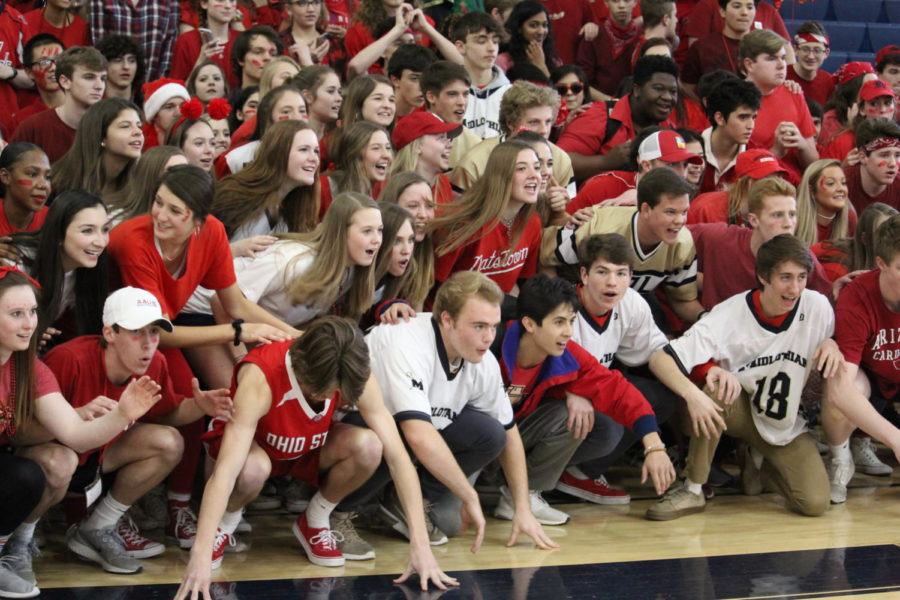 The junior class swarms the gym at the final pep rally of the year.