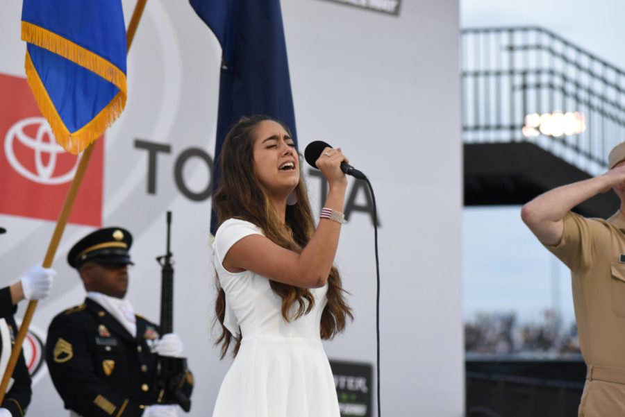 Midlo junior Sophia Nadder sings the National Anthem at Richmond Raceway at the Toyota Owners 400 Weekend.