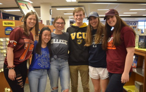 Morgan Sensabaugh, Chloe Naughton, Carrie Rowley, Ryan Maher, Elizabeth Czenczek, and Grace Wells display their future colleges during Spirit Week.