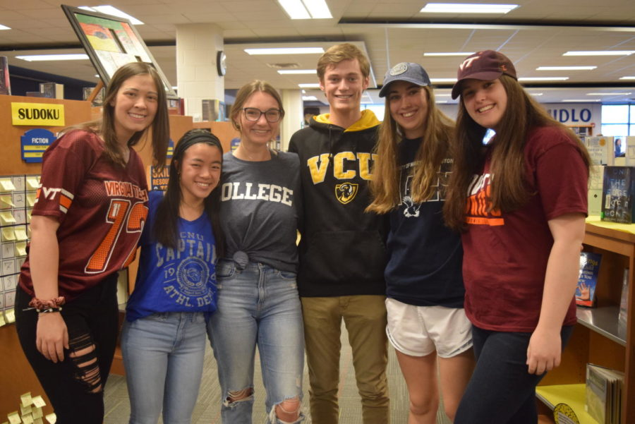 Morgan Sensabaugh, Chloe Naughton, Carrie Rowley, Ryan Maher, Elizabeth Czenczek, and Grace Wells display their future colleges during Spirit Week.