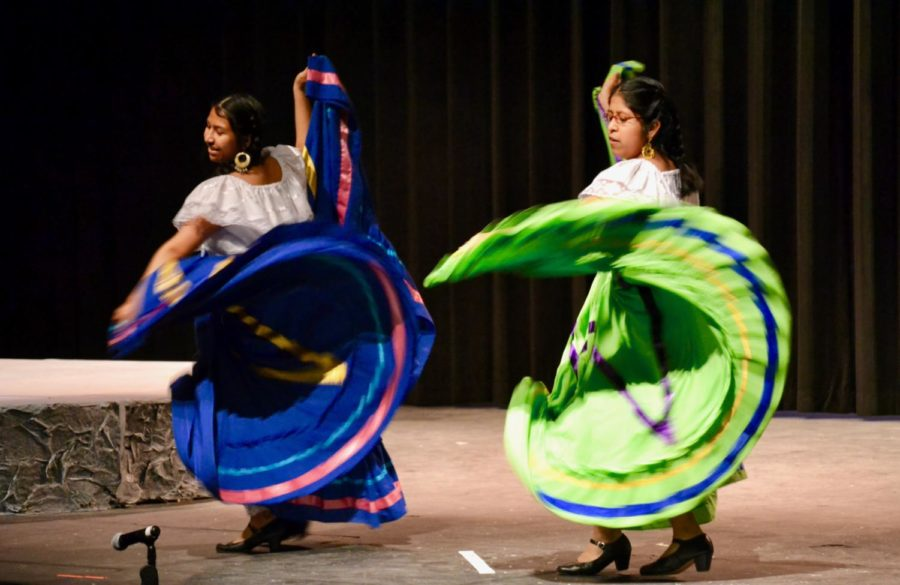 Alex Murias and Ashley Murias sway their skirts in a traditional Mexican dance at the International Festival.
