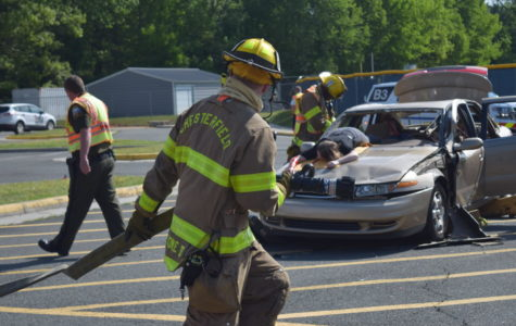 First Responders rush to the scene with a fire hose during Project Impact.