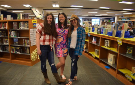 Grace Wells and Elizabeth Czenczek's country outfits clash with Morgan Sensabaugh's country club style during Senior Spirit Week.