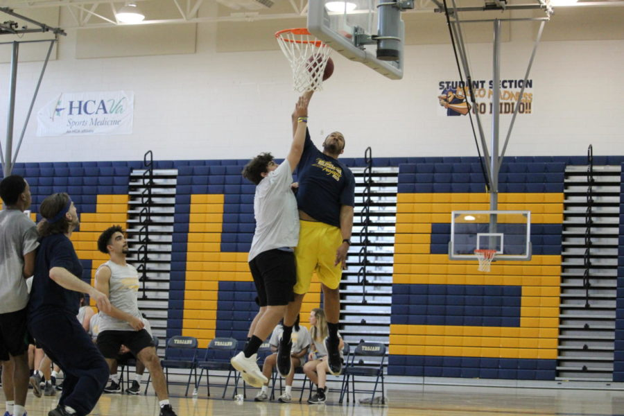 Kaeden+Daniels+attempts+to+block+Mr.+Jarhon+Giddings+as+he+jumps+up+to+shoot+during+the+Student+vs.+Faculty+Basketball+Game.+