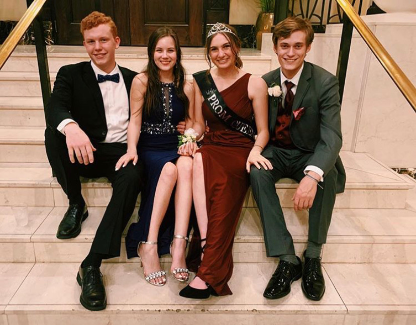 John+Kessler%2C+Caitlin+Woods%2C+Prom+Queen+Carrie+Rowley%2C+and+Ryan+Maher+celebrate+their+senior+prom+together+at+the+John+Marshall+Ballroom.+