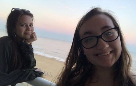 Caitlin Woods and Sarah Moskovitz watch the sunrise from their hotel balcony during spring break 2019.