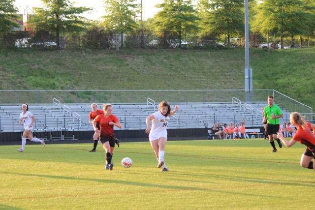 Senior Eleanor Ross connects a pass with her teammate in the Midlo vs. Powhatan soccer game.