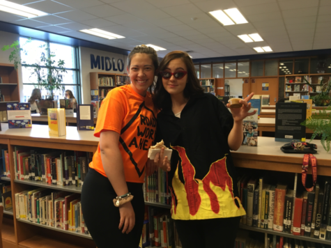 "Morgan Sensabaugh and Delaney Novak dress as ""Road Work Ahead"" and Guy Fieri."