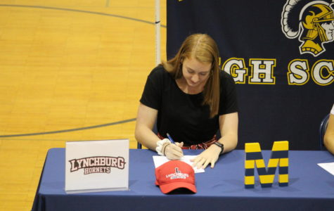 On April 17. 2019, Abbi Leeper signs to play volleyball at Lynchburg.
