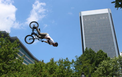 Monster BMX Bikers flip over the city during their performance at River Rock.
