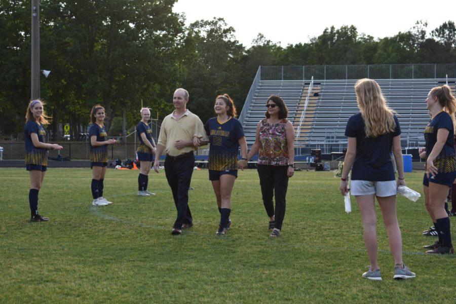 Eleanor Ross' family escorts her on Soccer Senior Night.
