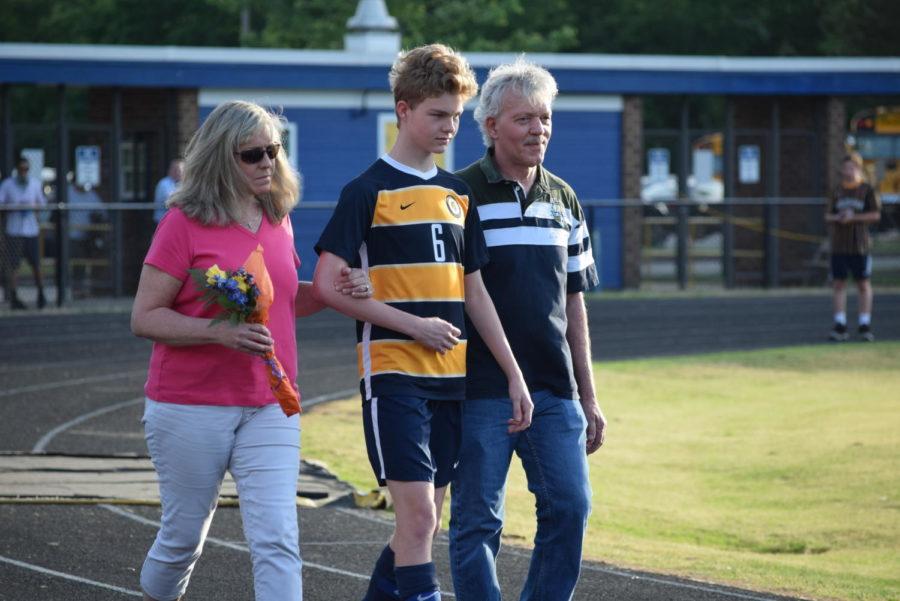 Kyle Kuennens family escorts him on Soccer Senior Night, 2019.