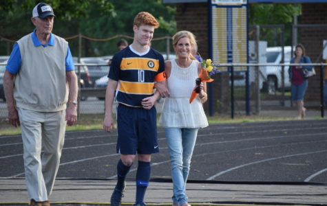 Bogue Cummings' family escorts him on Soccer Senior Night.