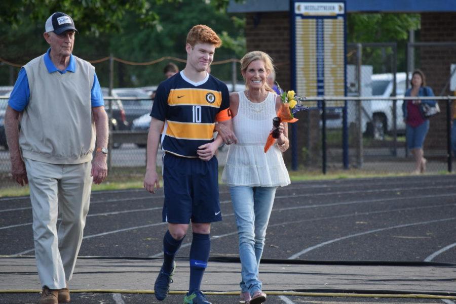 Bogue+Cummings%27+family+escorts+him+on+Soccer+Senior+Night.