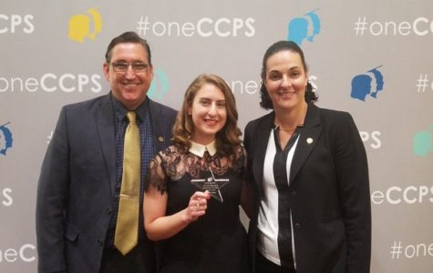 Midlothian High Assistant Principal Dr. Robert Gifford, CCPS Beginning Teacher of the Year, Ms. Hannah Foster, and Midlo Spanish teacher and mentor Mrs. JoAna Smith celebrated at the new teacher reception.