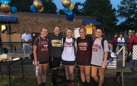 Midlo's senior lacrosse players gather after a game against the Godwin Eagles on Senior Night 2019.
