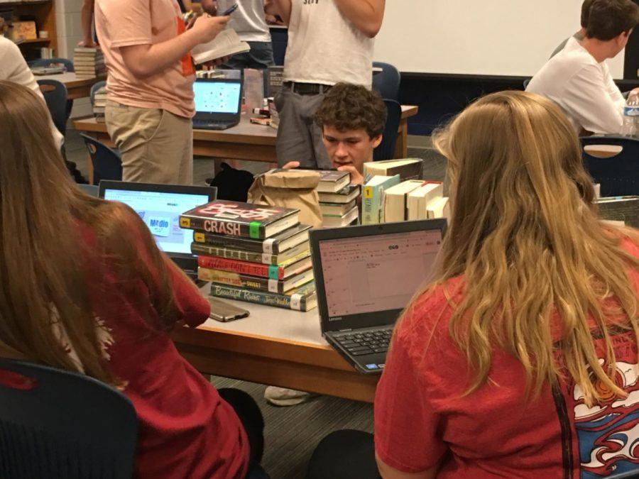 Senior Joe Hester creates Book Spine Poetry in Mrs. Tully's AP Lit class.