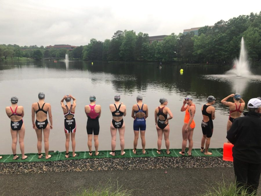 The+Junior+Elite+Females+line+up+at+the+swim+start+at+the+East+Coast+Triathlon+Festival.
