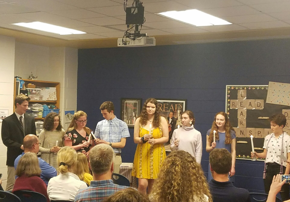 The French Honor Society lights the ceremonial candles during the spring induction.