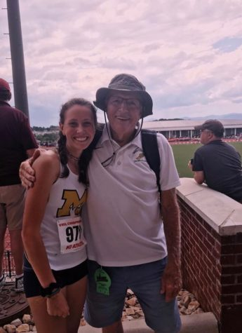 Sophomore Millie Weinhold and Coach Stan Morgan hug after the 2019 State Track and Field Meet.