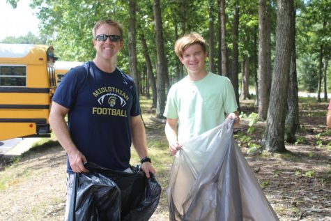 Principal Shawn Abel and his son, Jackson Abel, team up to beautify Midlothian High School.