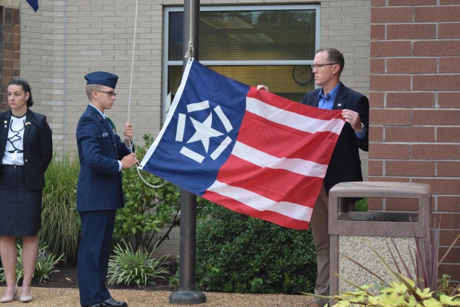 Sophomore Connor Long and Freedom Flag Foundation President Mr. John Riley raise the Freedom Flag for the very first time at Midlothian High School.
