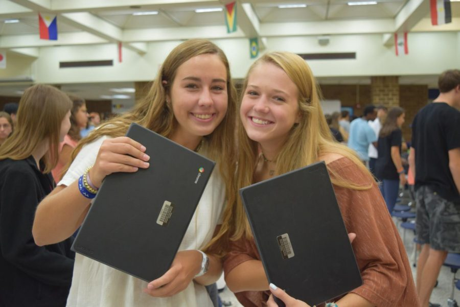 Lauren+Misson+and+Claire+Horansky+reunite+with+their+Chromebooks+at+the+2019+Chromebook+Rollout.+