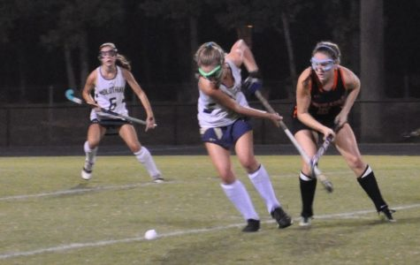 Ava Hammond hustles to gain possession of the ball in the game against Powhatan.