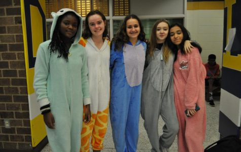 Midlo students wear cozy onesies, each representing different animals, during Homecoming Spirit Week 2019.