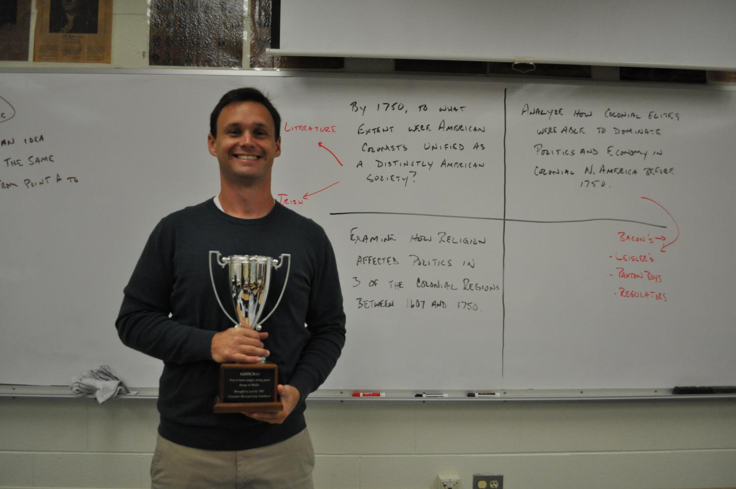 Mr. Fout holds the TRT trophy awarded by Mrs. Abrahamson.