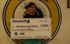 Freshman Brennan Lane collects $500 toward the Denim Drive.
