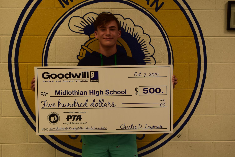 Freshman Brennan Lane collects $500 toward the Denim Drive.