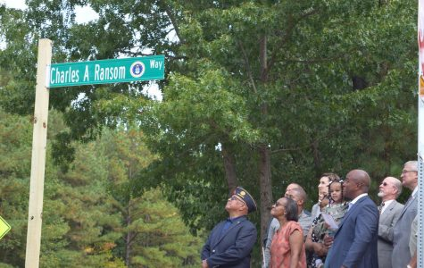 The family of Major Charles A. Ransom unveils the sign honoring Major Ransom.