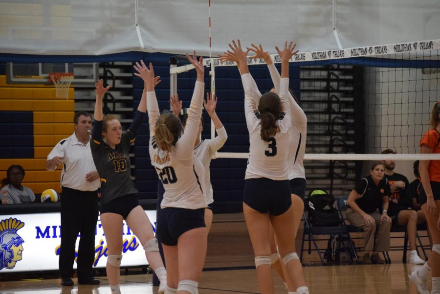 Midlo+girls+celebrate+gaining+a+point+after+a+block+at+the+Midlo+vs.+Monacan+Senior+Night+Volleyball+game.