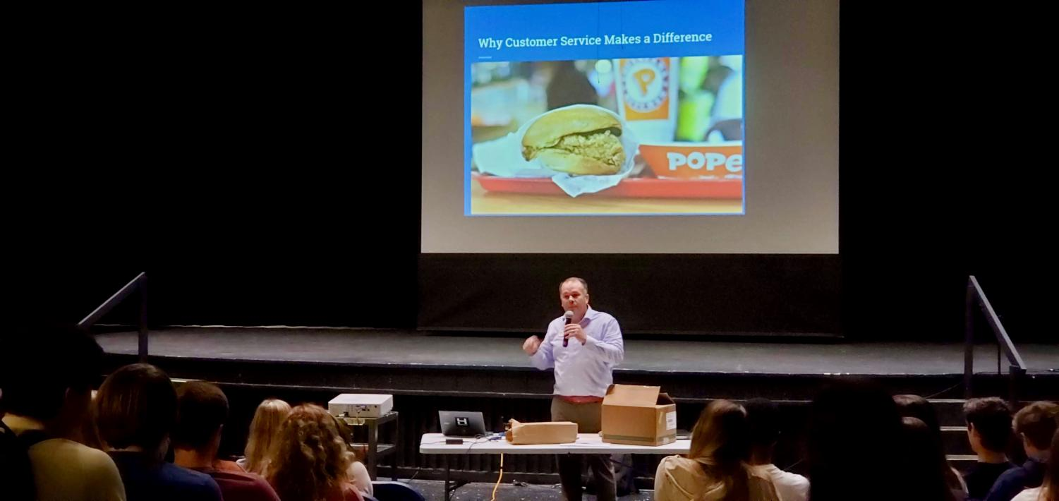 Erik DeVriendt, owner and operator of the Westchester Commons Chick-Fil-A, spoke to Midlothian High School FBLA members about the value of excellent customer service.