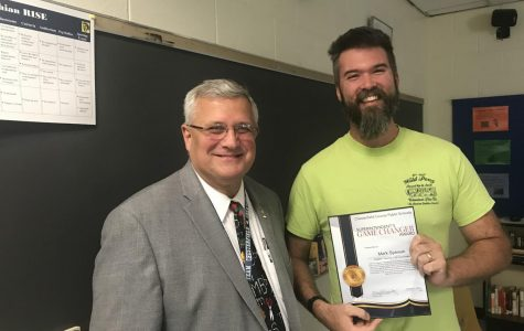 Mr. Mark Spewak receives the Game Changer Award from Superintendent Merv Daugherty.