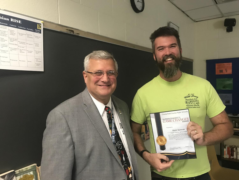 Mr. Mark Spewak receives the Game Changer Award from Superintendent Merv Daugherty.