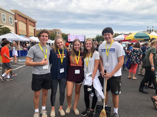 Del Herbert, Claire Horansky, Abigail Graves, Caroline Pickels, and Jeff Klaiber volunteer at the Midlothian Food Festival.