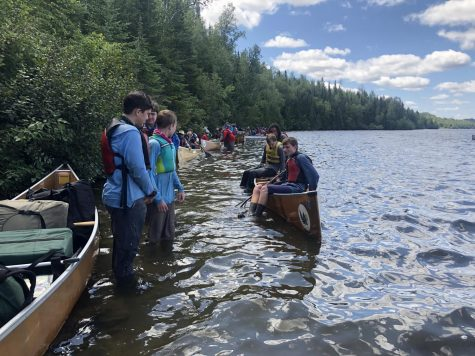 Scouts dock their canoes as they reach the Northern Tier base ready to go home.