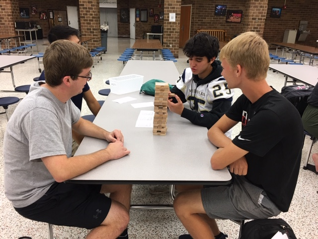 Juan Melchor reads the question to his groups of AP Literature students playing Literary Jenga.