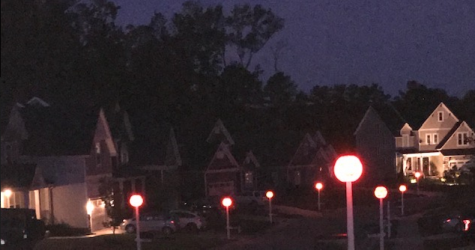 "The streets are lit up with ""Pumpkin Lights"" in Rountrey."