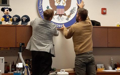 Dr. Shawn Abel, and Mr. Mark Spewak hang the National Blue Ribbon award.