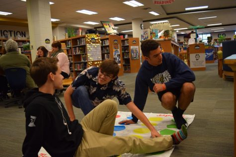 Students zone in on a game of Twister.
