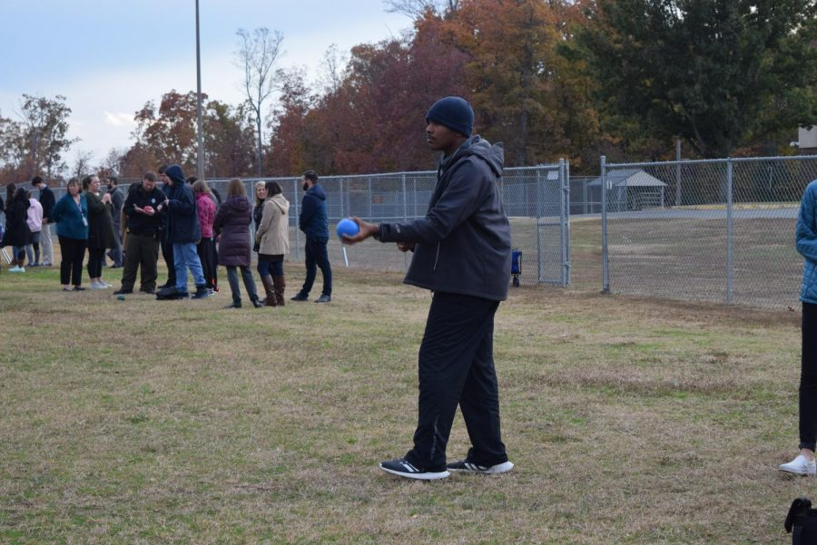 Joshua Burks prepares the roll ball at the Champions Together Bocce Tournament.