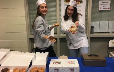 Mary Carson and Noelia McCaffery serve donuts at the IB Election Day Bake Sale.