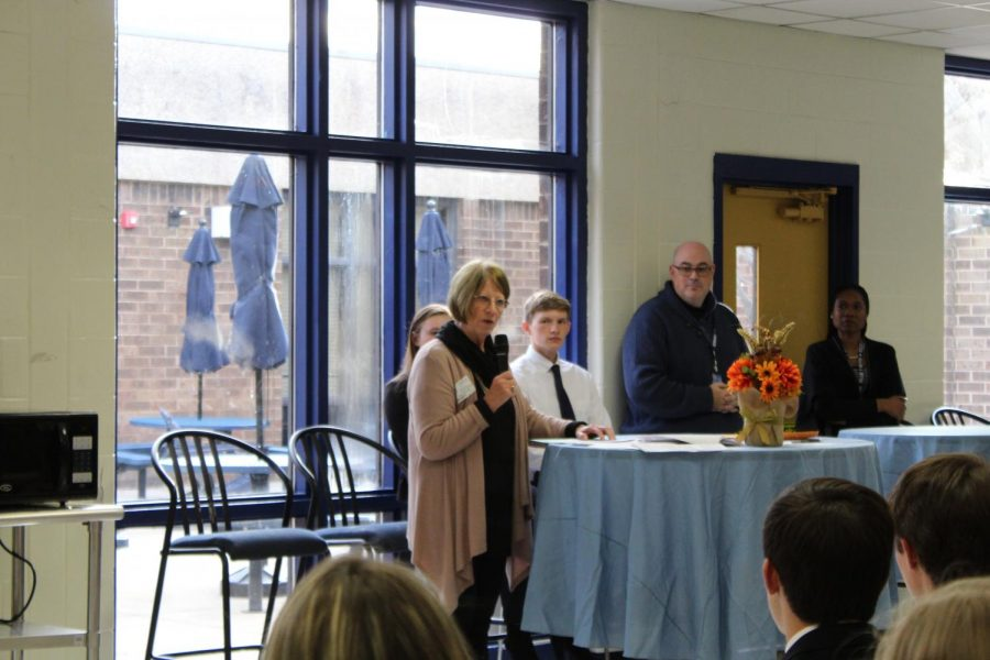 Judith Sams welcomes the new National Business Honor Society Members in Midlo's Closed Commons.