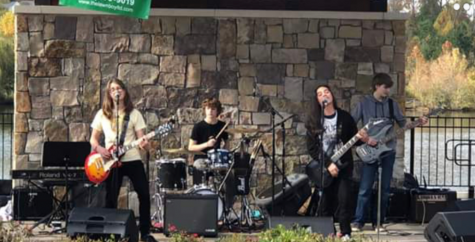 "The local rock band ""Highrise"" perform live at the Jack Ryan Music Festival."