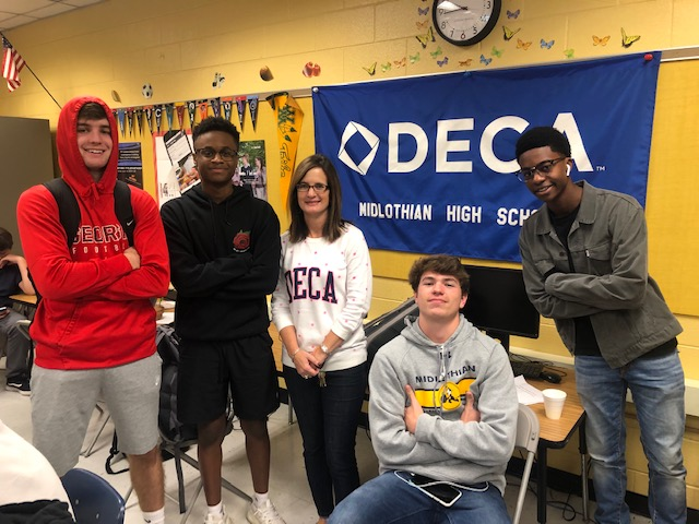 Jake Childers, Kaden Brown, Mrs. Carolyn Manheim, Derek Christmas, and Isaiah Azminia love competing at DECA competitions.