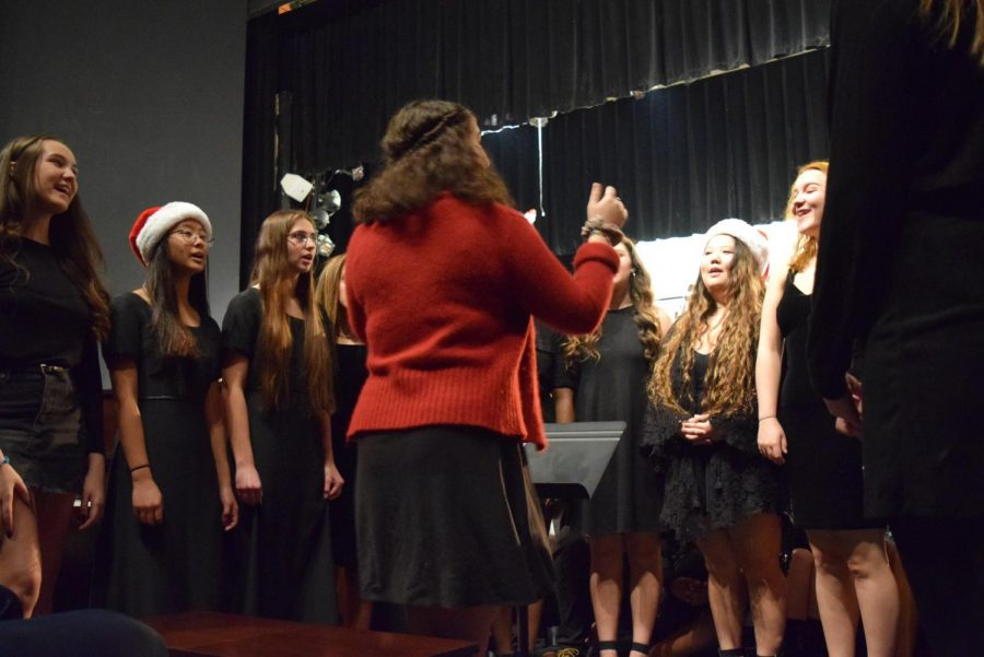 Nicole Dudley directs Pitch Perfect as they perform Santa Baby.